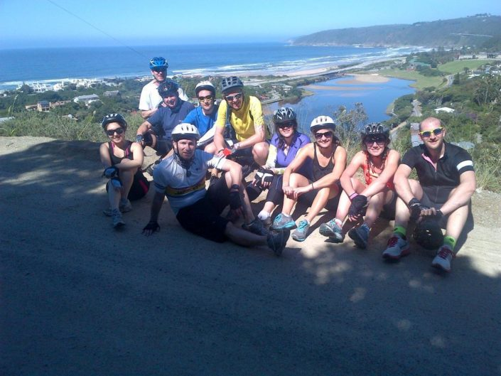 ABC bike and hike challenge - The biker group takes a beautiful photo with the horizon in the distance.