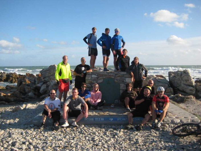 ABC bike and hike challenge - The bike group makes a quick stop for a group photo by the sea.